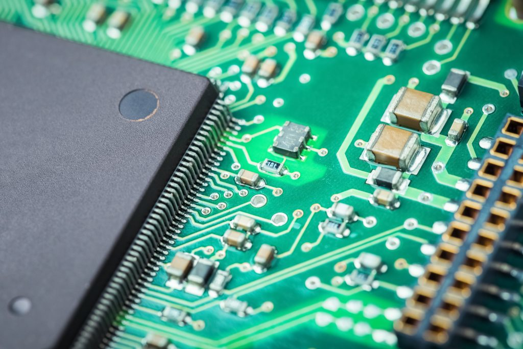 electronic board closeup , microelectronics and semiconductors industry background